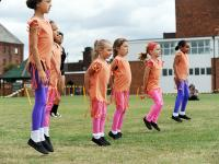 Young girls perfom a dance routine